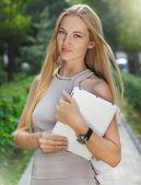 Businesswoman using electronic tablet outside — Stok fotoğraf