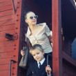 Woman with her son in the retro train — Stock Photo #26388613