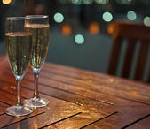 Champagne in the glasses on the table — Stock Photo