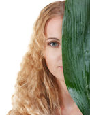 Portrait of the beauty young blond woman with green leaf — Stock Photo