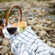 Red wine, cheese and bread served at a picnic — Stock Photo #26526171