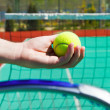 Stock Photo: Close up of tennis racquet and ball in hands