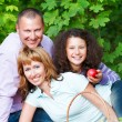 Happy young family outdoors — Stock Photo