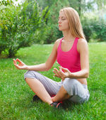 Attractive young woman doing yoga — Stock Photo
