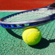 Close up of tennis racquet and ball — Stock Photo #26871863