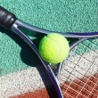 Stock Photo: Close up of tennis racquet and ball