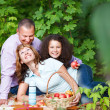 Happy young family with daughter on picnic — Stock Photo