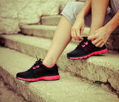 Woman trying running shoes getting ready for jogging — Stock Photo