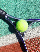 Close up of tennis racquet and ball — Stock Photo