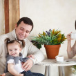 Happy smiling family with one year old baby girl indoor — Stock Photo