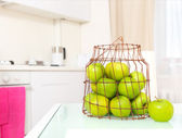 Green apples on the white kitchen — Stock Photo