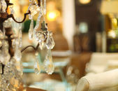 Chrystal chandelier close-up in living room — Stock Photo