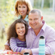 Happy young family with daughter on picnic — Stock Photo #28043251