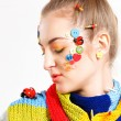 Young blond woman with creativity hairstyle with colored buttons — Stock Photo #29388651