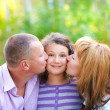 Happy young family with daughter — Stock Photo #29388897