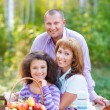 Happy young family with daughter — Stock Photo
