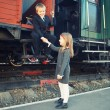 Little boy and little girl near the train — Stock Photo