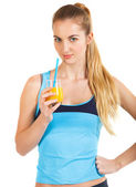 Attractive sporty woman with orange juice — Stock Photo