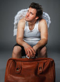 Mr. Angel with brown bag — Stock Photo