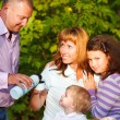 Happy young family with daughters on autumn picnic — Stock Photo