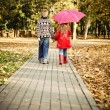 Little boy and little girl in the autumn park — Стоковая фотография