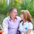 Happy smiling couple in the autumn forest on the picnic — Stock Photo