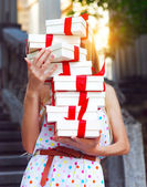 Gift boxs in the hands of young woman — Stock Photo