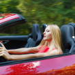 Young woman driving a sports car — Stock Photo