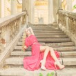 Stock Photo: Beautiful blond womin long dress outdoors