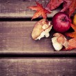 Stock Photo: Autumn wooden background with mushrooms and apples
