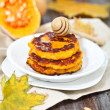 Pumpkin pancakes with honey  — Stock Photo