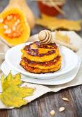 Pumpkin pancakes with honey — Stock Photo