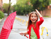 Little girl under the rain — Stock Photo