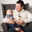 Happy father with one year old baby girl indoor — Stock Photo