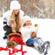 Happy young mother with daughter on winter picnic — Stock Photo