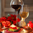 Christmas still life with white and red wine  — Стоковая фотография