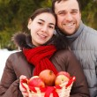 Stock Photo: Happy young couple in the winter park