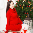 Happy young pregnant woman near the Christmas tree — Stock Photo