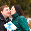 Happy young couple in love with present — Stock Photo #33220129