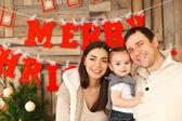 Happy family with near the Christmas background — Stock Photo