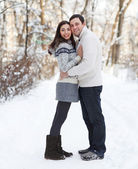 Happy young couple in the winter park — Stok fotoğraf