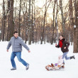 Young happy family in winter park — Stock Photo #33506801