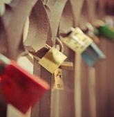 Love locks hang from a bridge in Prague — Stock Photo