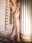Beautiful blond woman in long dress outdoors — Stock Photo