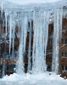 Frozen window with icicle on it — Stock Photo