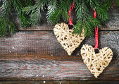 Christmas fir tree with Christmas decorations on the wooden back — Foto Stock