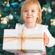 Adorable little girl with Christmas present  — Stock Photo