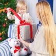 Happy mother with her little daughter. Christmas — Stock Photo
