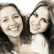 Black and white close up portrait of a mother and teen daughter — Stock Photo #38053629