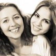 Black and white close up portrait of a mother and teen daughter — Stock Photo